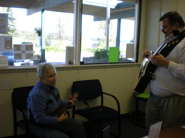 Mike takes time to play some music with local musician.