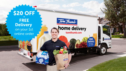 Delivery man standing in front of Tom Thumb delivery truck holding groceries.