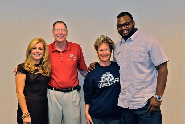 With Leigh Ann Touhy and Michael Oher at Championship