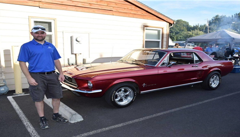 Adam and his Mustang at a bbq