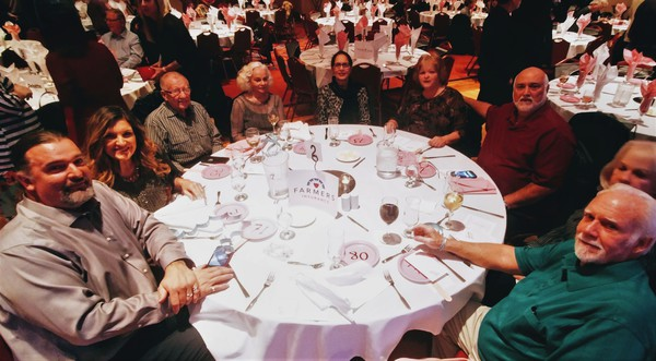 Group of people at a fundraiser sitting at tables