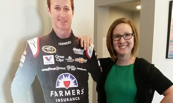 Crystal poses proudly by Kasey Kahne after earning her property and casualty license.