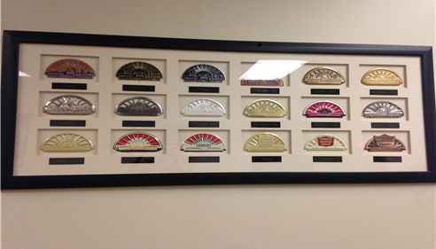 Framed collection of old Farmers logos