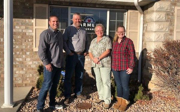 Group photo of Agency in front of the office on a Fall day.