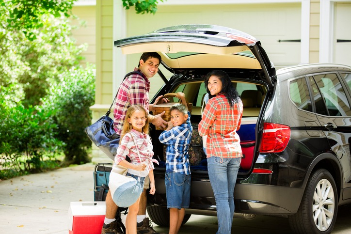 family of four packing up the trunk of their SUV