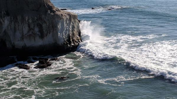 Wave clashing with rock