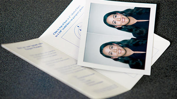 brunette woman's passport photos taken at the ups store