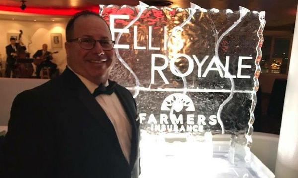 Agent Joel at District Gala next to ice sculpture