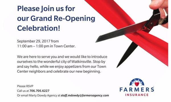 Photo of a ribbon cutting advertising our Gran Re-Opening