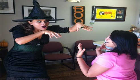 A scary witch casts a hex on an innocent Farmers Insurance agent!