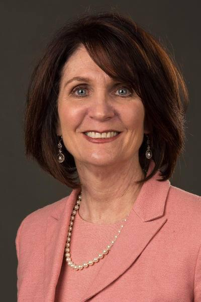 Allstate agent Debbie Braquet in front of a grey background