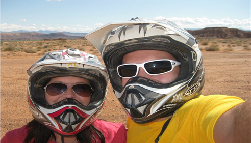 Agent and man wearing sunglasses and motorcycle helmets