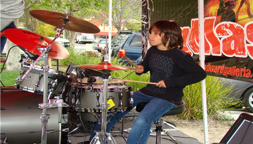 My son Zayne, the Drummer playing at a show at Keyboard Galleria Music Center.