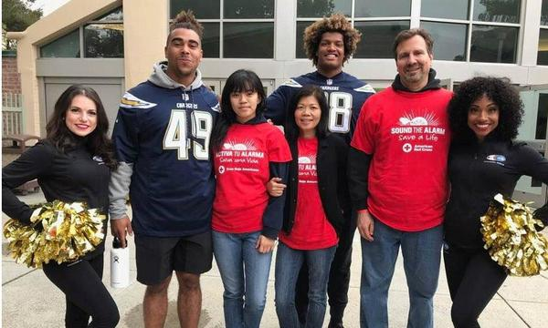 Taking pics with 2 LA Charger football players at the Red Cross event