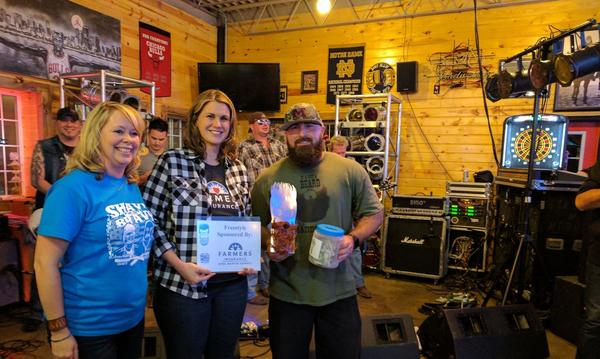 "Gina presenting the award for ""Best Freestyle,' at the April 7th Shave For the Brave event."