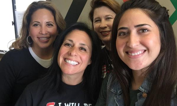 group of 4 women smiling at the camera