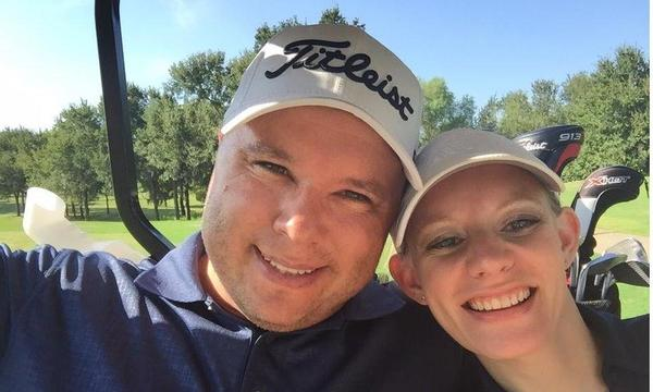 My husband and I golfing.