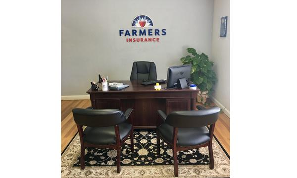 Office with Farmers Insurance emblem on the wall