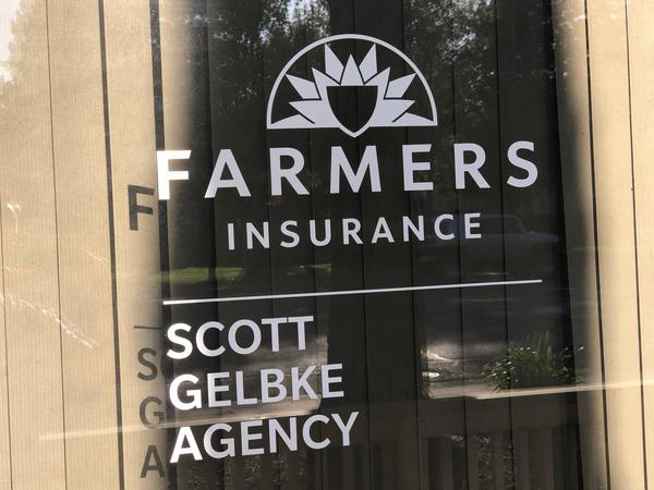 Image of window with the Farmers logo on it