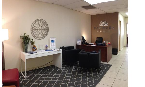 The inside of a Farmers Insurance office, complete with an alluring grey rug.