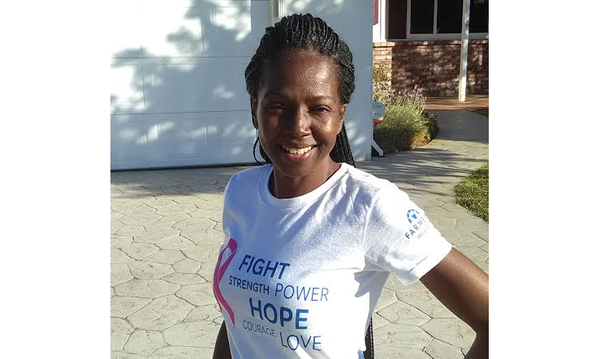 Agent Felicia Traylor wearing a Breast Cancer Awareness t-shirt.