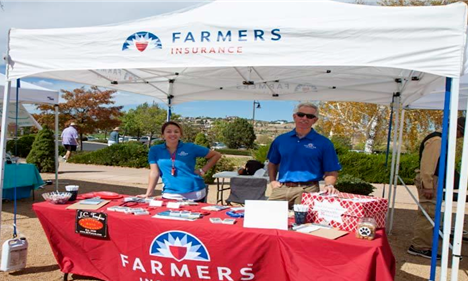 Agent and staff at a Farmers booth