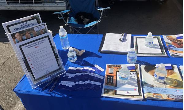 table covered with brochures and pamphlets