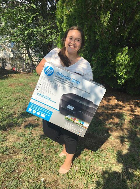 Picture of person posing with Printer to donate to teachers