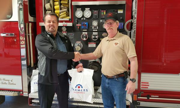 Agent dropping off care package to local fire department.