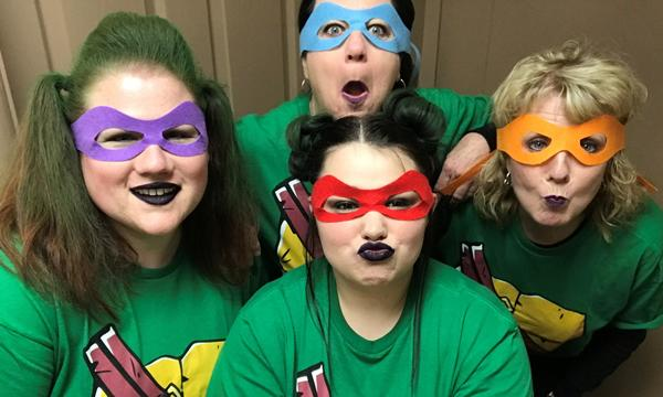 The Farmers Agency staff dressed as Ninja Turtles.