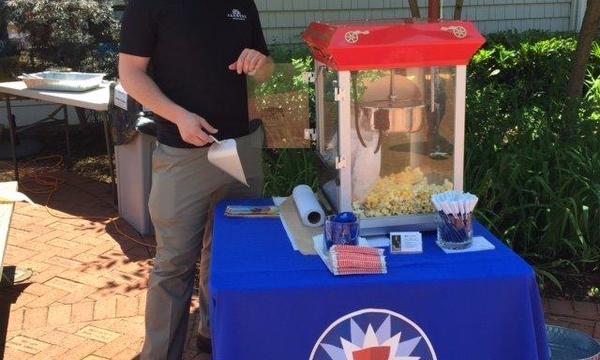 Providing popcorn at community lunch events.