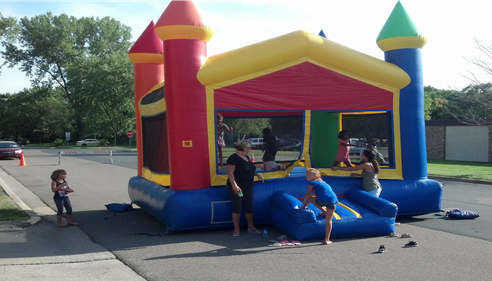 Kids having a blast at the Neighborhood Block Party.