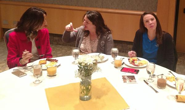 Amanda and some teachers enjoying an early morning breakfast.