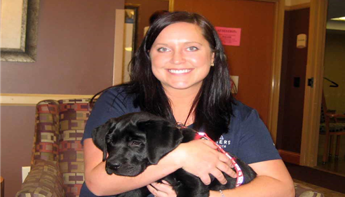 Erin with Coal- her Can Do Canine she was a puppy raiser for.