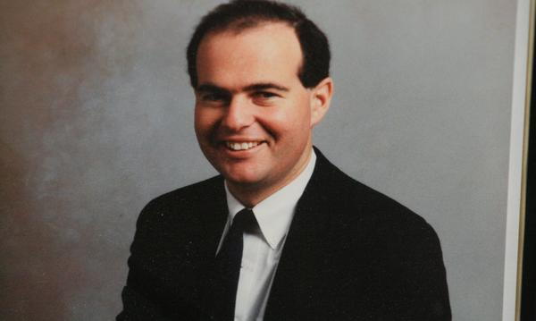 Professional photo of Agent Barry Samuels in a suit from 1987