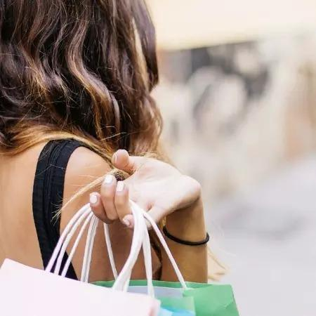 Woman holds shopping bags
