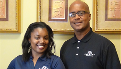 Farmers® Agent Eugene Moseley and daughter Janelle.