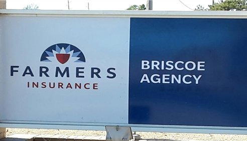The Farmers agency's business sign.