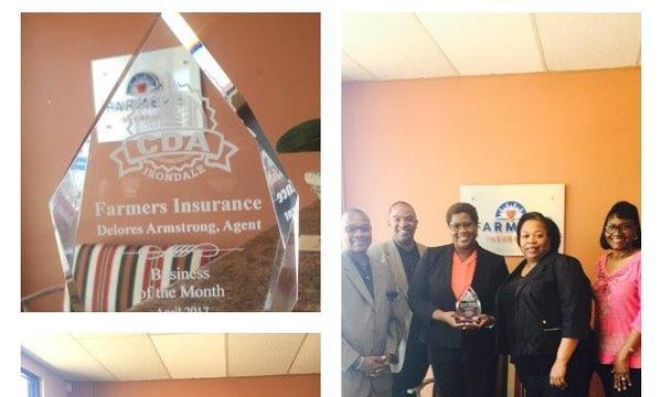 Agent, standing next to four members of her staff, holding the Irondale Commercial Development Authority Business of the Month Award