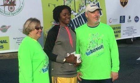 Rotary of Dunwoody President, Tina Philpot and 2016 RunDunwoody Race Director, Bob O'Brien with one of the winners at this year's race in October.