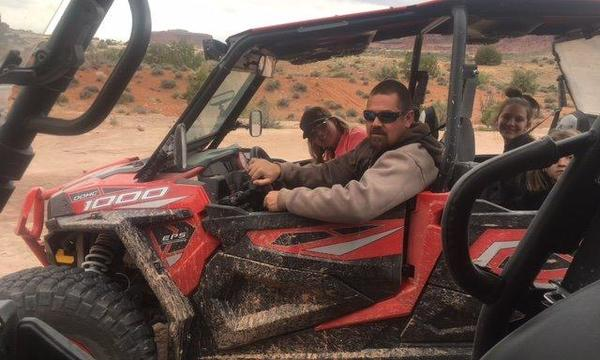 Our Tami having fun at Moab - insure your toys with us.
