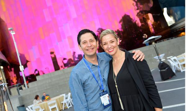 Agent and wife standing together at an event