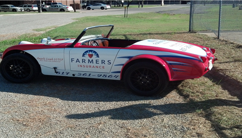 Car decorated with Farmers Insurance emblems