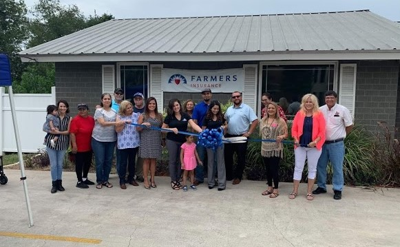 Group of agents at an office ribbon cutting