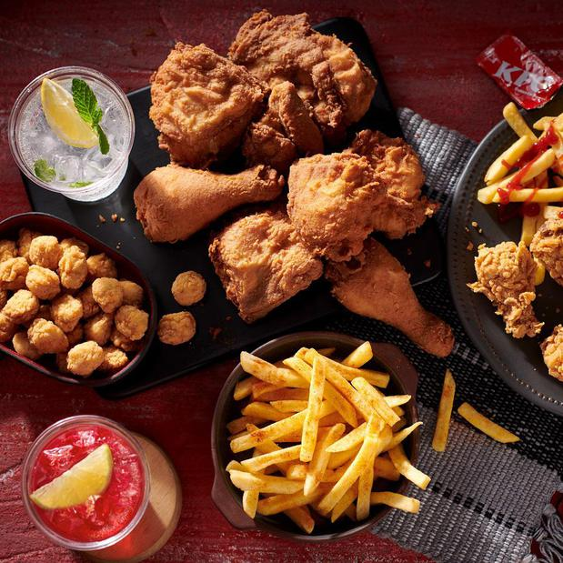 Image of KFC chicken pieces, fries, and drinks