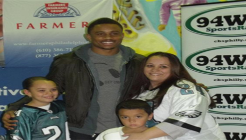 "Nnamdi Asomugha with the winner of ""Take a Player to School"" contest."