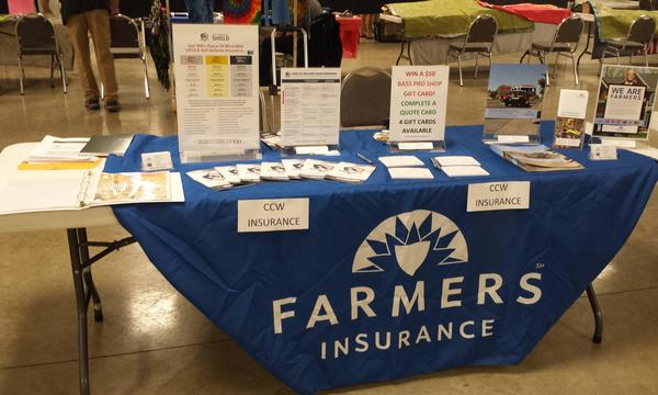 Agent Randall Mueller's Farmers Insurance table at the Brown County Gun Show.