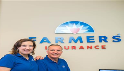 Rich Winters with Jennifer Winters-Riggs with their new Farmers® sign and logo.