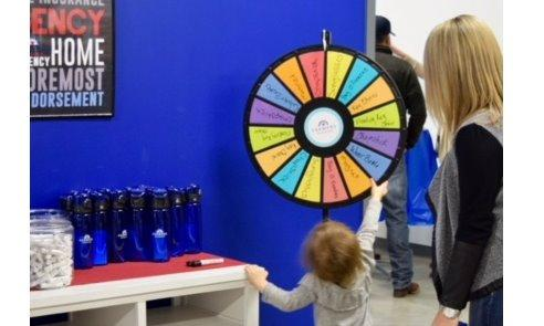 Discount spinner at agency open house