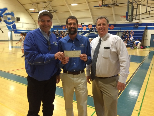 Agent giving check to  King City High School Mustang Sports Faculty